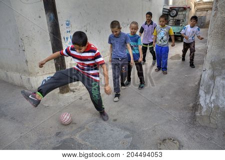 Fars Province Shiraz Iran - 18 april 2017: Iranian teenagers play football in the yard.