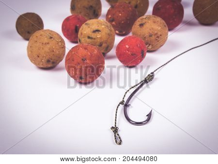 Close Up of Carp Hook Boilies isolated on white background .