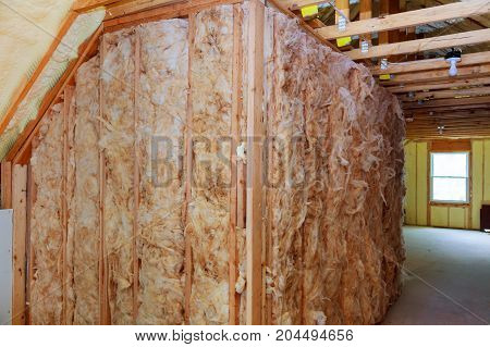 Heat Insulation And Wooden Logs Lathing Ready For Finishing Made Of Tongue And Groove Planks.