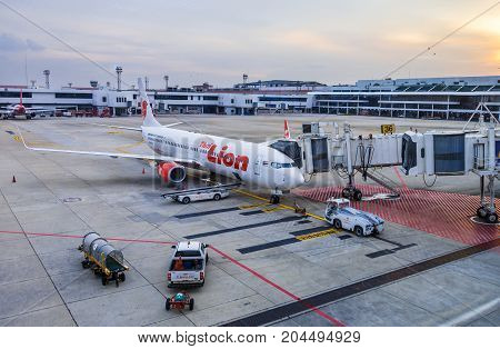Bangkok Thailand - 14 September 2017 - Thai Lion Air aircraft waits for passengers while technician checks on the engine at Don Muang International Airport Bangkok Thailand on September 14 2017