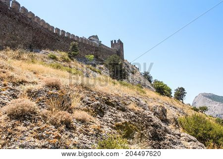 Watch tower with a wall. Genoese ancient fortress near the city of Sudak.