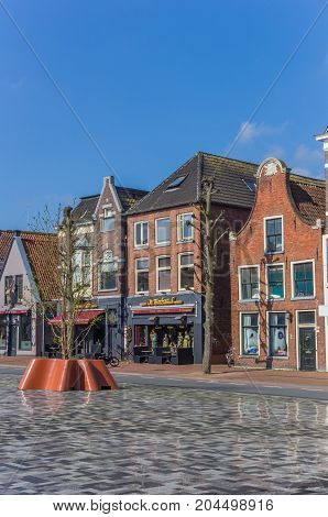 GRONINGEN, NETHERLANDS - APRIL 02, 2017: Historic facades at the Damsterplein square in Groningen Holland