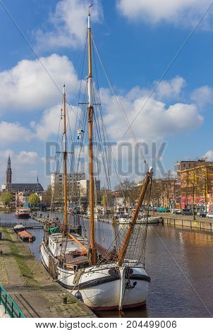 GRONINGEN, NETHERLANDS - APRIL 02, 2017: Traditional dutch sailing ship in the east harbor of Groningen Netherlands