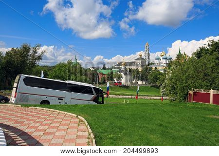 Tourist bus on the road in front of the Trinity Lavra of St.Sergius. Sergiyev Posad, Golden Ring, Russia