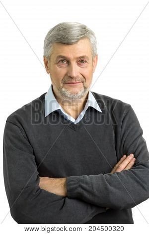 Serious mature man with crossed arms. Portrait of late-middle-aged man with crossed arms on white background.