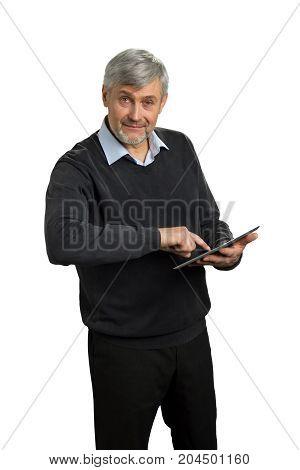 Mature man using computer tablet. Senior entrepreneur working on digital computer tablet with index finger on white background.