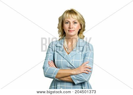 Mature woman with crossed arms portrait. Beautiful adult lady with crossed arms stading on white background.
