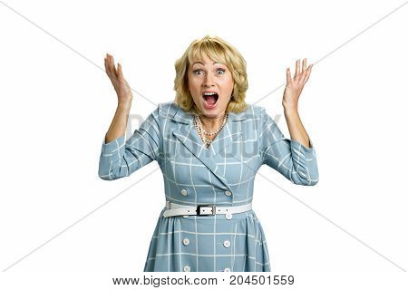 Surprised mature women raised hands. Adult woman with open mouth and eyes raised hands in confusion. Facial expression and body language.