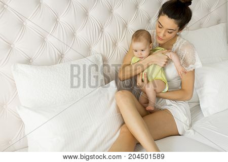 Young Mother Holding Her Litle Daughter