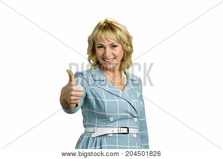 Smiling mature lady raised thumb up. Positive older woman with thumb up isolated on white background.