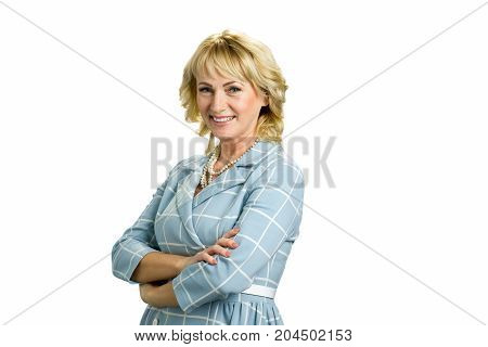 Mature woman with crossed arms. Smiling middle age woman crossed arms standing on white background, side photo.