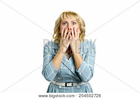 Shocked and horrified mature woman. Surprised white-skin woman covering mouth with hands on white background. Human facial expressions and emotions.