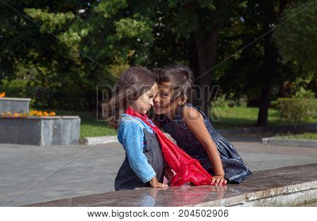 MOSCOW RUSSIA - SEPTEMBER 102017: Two little girls talking in the park