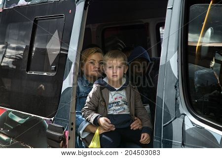 MOSCOW RUSSIA - SEPTEMBER 162017: A woman with son on her lap sits on the bus