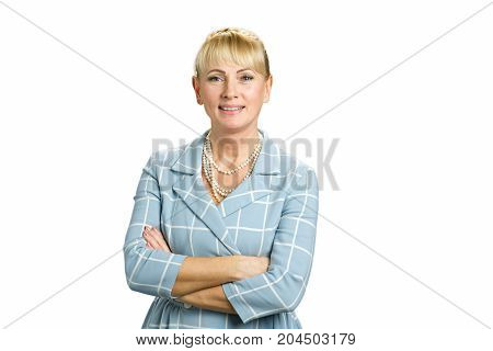 Portrait of beautiful mature woman. Attractive middle aged woman crossed arms isolated on white background.