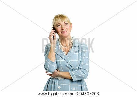 Middle aged woman talking on phone. Closeup portrait white-skin mature business woman happy, excited employee, using cell phone, smiling. Happy mid woman using mobile phone on white background..