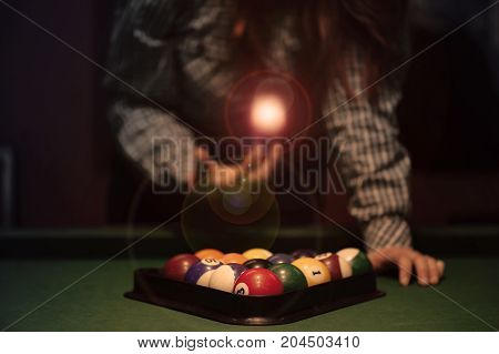 American billiard poule. Triangle of billiard balls. A man getting ready to start a game of billiards.