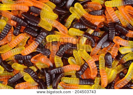 halloween gummy worm candy making a background