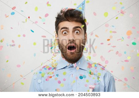 Surprised Handsome Man With Beard, Stares At Camera, Celebrates Promotion On Work, Being Shocked To
