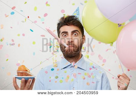 Portrait Of Attractive Man With Beard, Comes To Mother, Congratulates Her With Birthday, Holds Ballo
