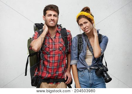 Tiredness And Weariness Concept. Two Fatigue Male And Female Travellers Carry Heavy Bags, Look With
