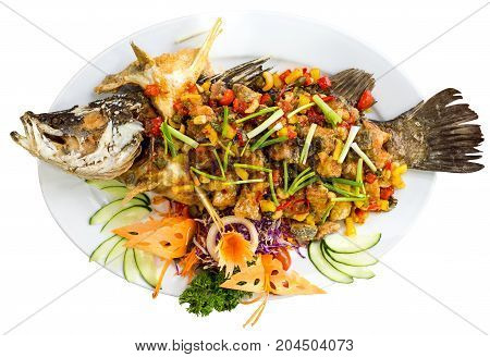 Plate Of Grilled Fish With Vegetables - Isolated On White. Top View