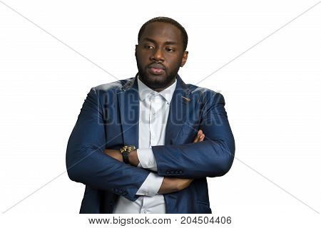 Afro american businessman on white background. Young serious afro american director with crossed hands. Black thoughtful man in suit crossing hands.