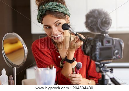 Candid Shot Of Cute Young Caucasian Woman Blogger Presenting Beauty Products And Broadcasting Live V