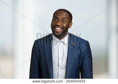 Smiling afro american businessman. Young cheerful smiling afro american businessman. Black businessman with wide smile.