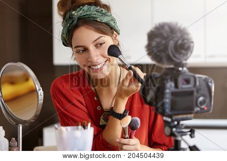 Portrait Of Beautiful Smiling Female Vlogger Makes Video Review, Uses Cosmetic Product, Records Usef
