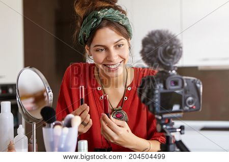 Attractive Cheerful Popular Young Woman Video Blogger Advertising Beauty Products Via Her Blog On So