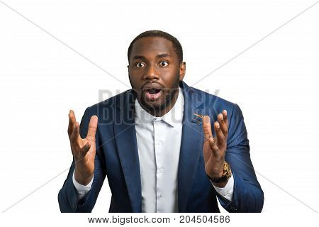 Surprised businessman on white background. Afro american man with feelings of amazement and curiosity.