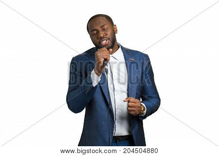 Afro singer with closed eyes. Bearded singer on white background. Great passion and talent.