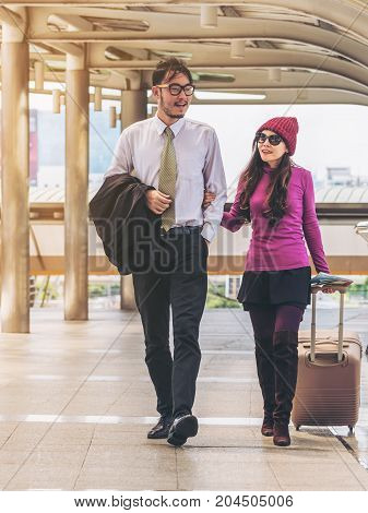Couple Travellers Walking In Airport Walkway