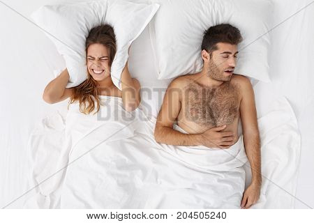 I Still Hear Noise. Frustrated Female Being Angry With Husband Who Produces Loud Sound During Sleep,
