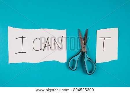 Conceptual Image Of Cutting A Paper That Reads We Cant