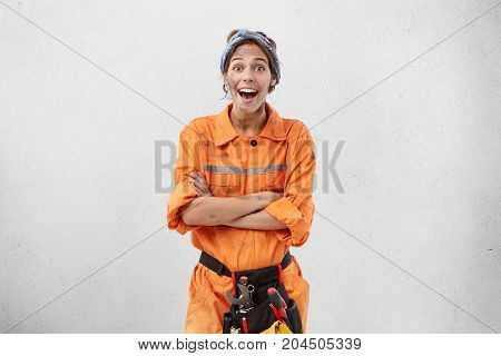 Repairing, Remodeling And Renovation Concept. Astonished Bug-eyed Young Female Worker Of Maintenance