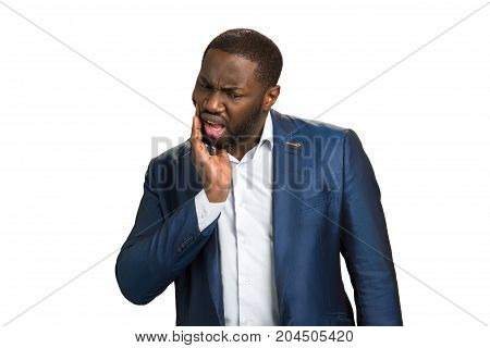 Afro american businessman feeling tooth pain. Toothache and dentistry. Terrible strong teeth pain.