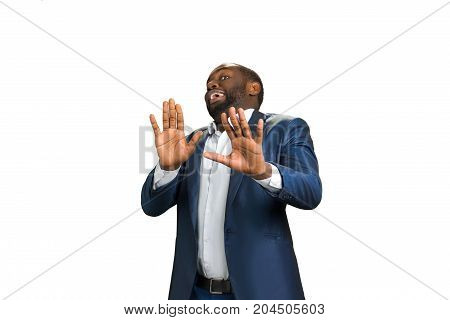Businessman holding his hands outstretched. Afro american young man. Surprised and scared businessman. Young manager with hands outstretched, warding off any unwelcome situations.