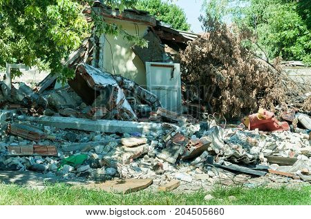 Abandoned civilian house in East Ukraine damaged by grenade explosion in the war zone