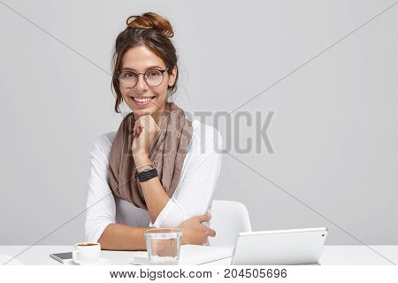 Confident Attractive Young European Businesswoman Wearing Stylish Eyeglasses And Scarf Having Rest A