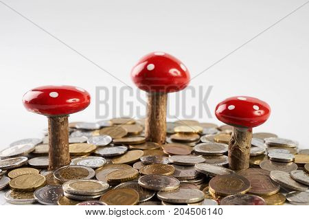 Growing Plant Mushroom On Row Of Stacked Coins