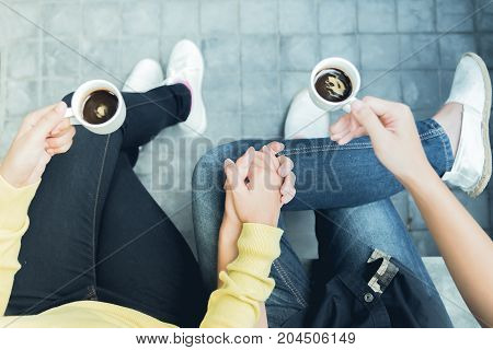 Couple enjoying coffee .Overhead of a couple sitting close with coffee