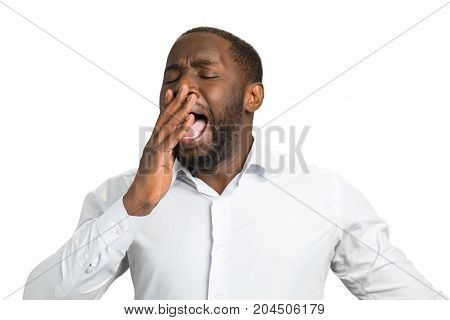 Yawning afro american entrepreneur. Sleepy manager on white background. Concept of a long hours work.