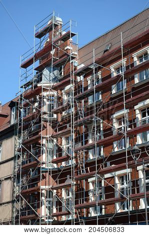 Scaffolding on a townhouse - renovation of an old tenement house