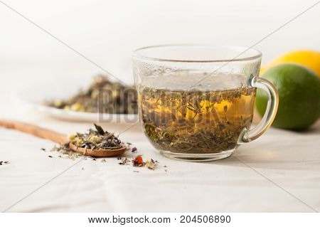 Herbal Tea From Medicinal Herbs On A White Table