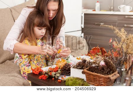 Souvenirs from natural materials with your child with your own hands. Teaching making crafts from pine cones acorns autumn leaves twigs berries.