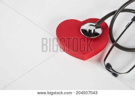 Red Heart And A Medical Stethoscope Isolated On White