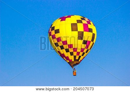 Bright Multi Colored Hot Air Balloon In Early Morning