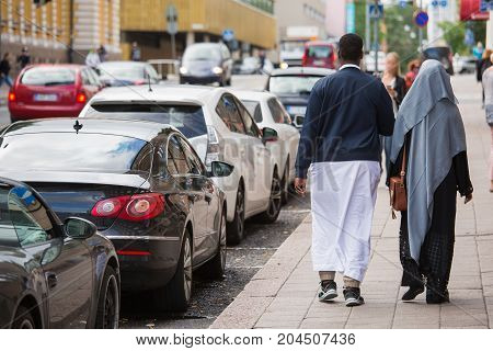 Emigrants on the street of european city